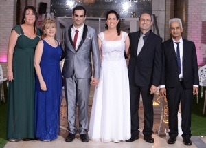 With the bride's parents, Bat-Sheva and Yaacov. (Photo credit: מגנט TEAM, copyright.)